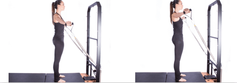 mulher realizando exercício de abdução de ombros no tower metalife pilates